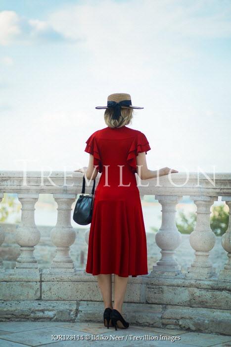 Ildiko Neer Vintage woman standing on balcony
