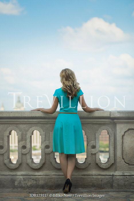 Ildiko Neer Blonde woman standing on terrace