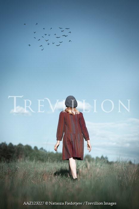 Natasza Fiedotjew Vintage girl walking away in fields