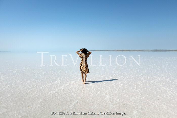 Esmahan Ozkan WOMAN WALKING ON SALT FLATS Women