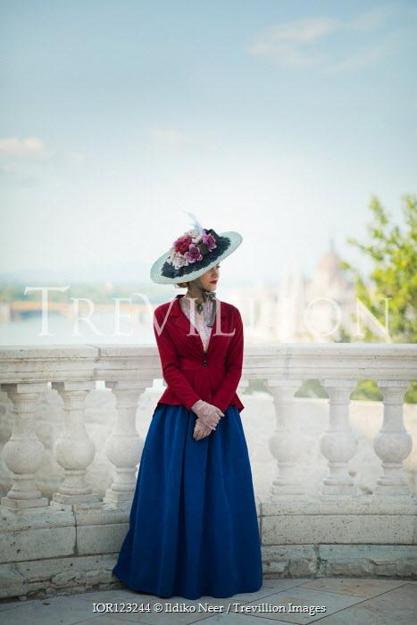 Ildiko Neer Victorian woman standing on balcony