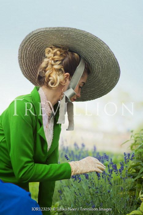 Ildiko Neer Victorian woman touching lavender