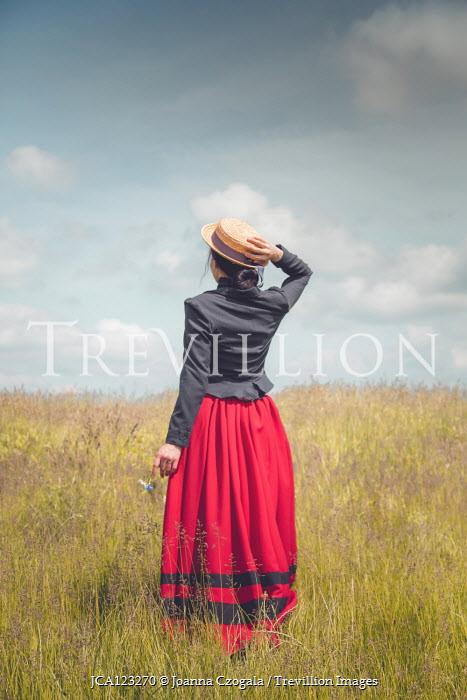 Joanna Czogala WOMAN WITH STRAW HAT IN SUMMERY FIELD Women