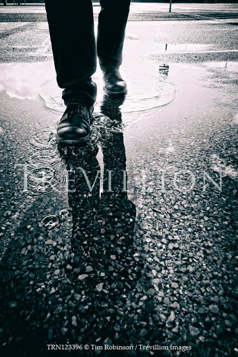Tim Robinson MALE FEET WALKING IN PUDDLE IN CAR PARK Men