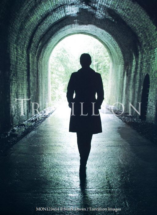Mark Owen SILHOUETTED WOMAN WALKING IN TUNNEL Women