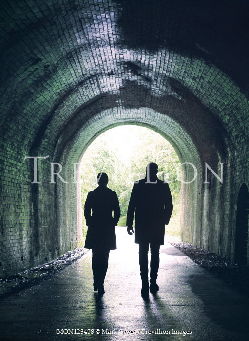 Mark Owen SILHOUETTED COUPLE STANDING IN TUNNEL Couples