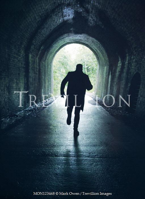 Mark Owen SILHOUETTED MAN RUNNING IN TUNNEL Men