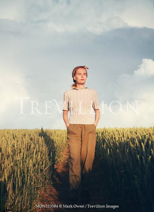 Mark Owen WOMAN WALKING IN SUMMERY WHEAT FIELD Women