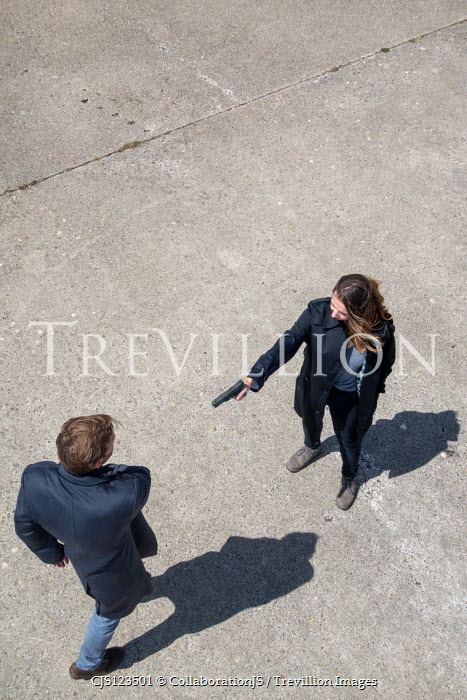 CollaborationJS WOMAN POINTING GUN AT MAN FROM ABOVE Women
