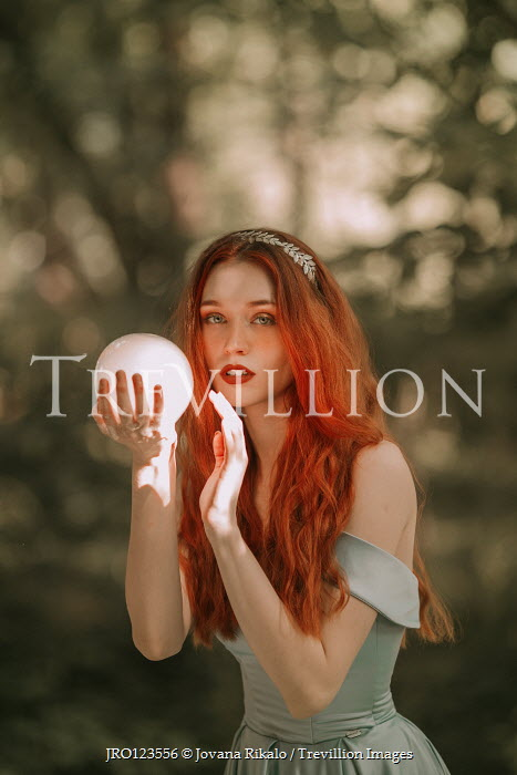 Jovana Rikalo WOMAN WITH RED HAIR HOLDING CRYSTAL BALL OUTDOORS Women