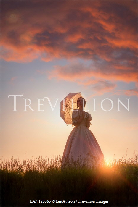 Lee Avison victorian woman in silhouette at sunset