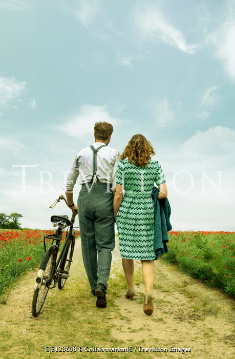 CollaborationJS RETRO COUPLE WALKING IN COUNTRYSIDE WITH BICYCLE Couples
