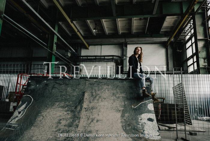 Daniil Kontorovich TEENAGE GIRL SITTING IN OLD FACTORY Women