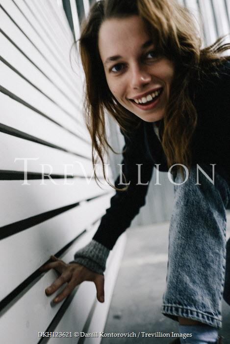Daniil Kontorovich SMILING GIRL CROUCHING BY FENCE Women