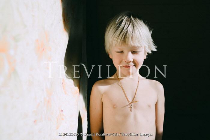 Daniil Kontorovich LITTLE BLONDE BOY WEARING CRUCIFIX IN SUNLIGHT Children