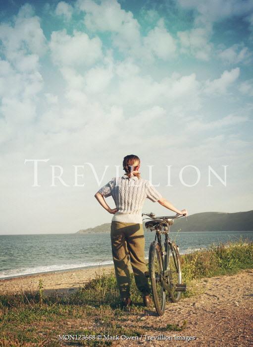 Mark Owen BLONDE GIRL WITH BICYCLE WATCHING OCEAN Women