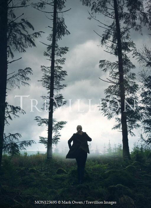 Mark Owen WOMAN RUNNING IN FOREST AT DUSK Women