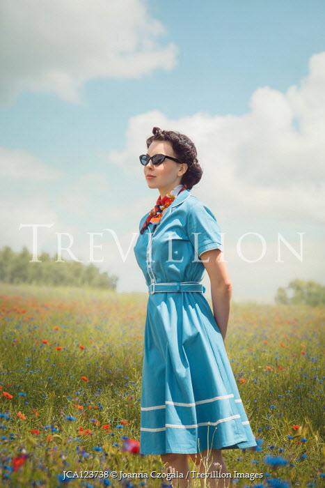 Joanna Czogala WOMAN IN SUNGLASSES STANDING IN SUMMERY MEADOW Women