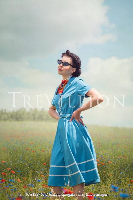 Joanna Czogala RETRO WOMAN STANDING IN SUMMERY MEADOW Women
