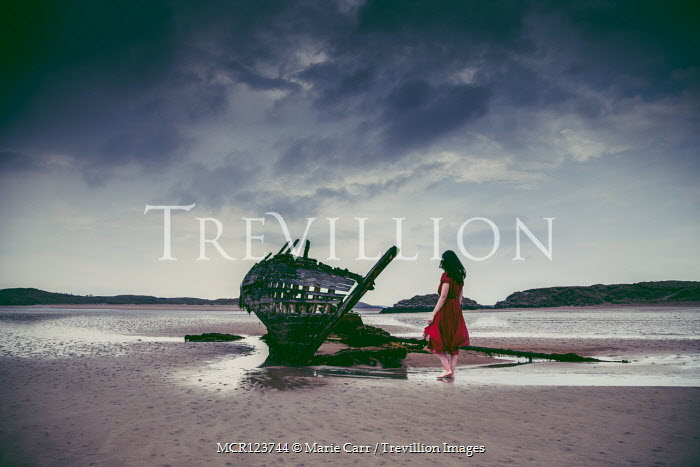 Marie Carr WOMAN WALKING ON BEACH BY SHIPWRECK Women