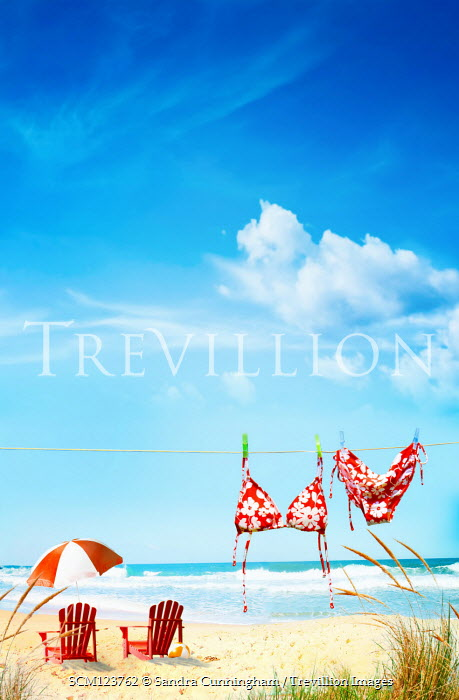 Sandra Cunningham BIKINI ON WASHING LINE WITH DECKCHAIRS ON BEACH Seascapes/Beaches