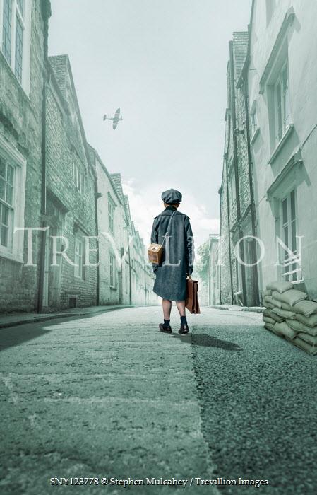 Stephen Mulcahey WARTIME BOY WALKING IN STREET WITH AEROPLANE Children