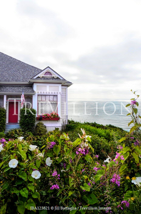 Jill Battaglia PRETTY HOUSE BY SEA WITH FLOWERS IN GARDEN Houses