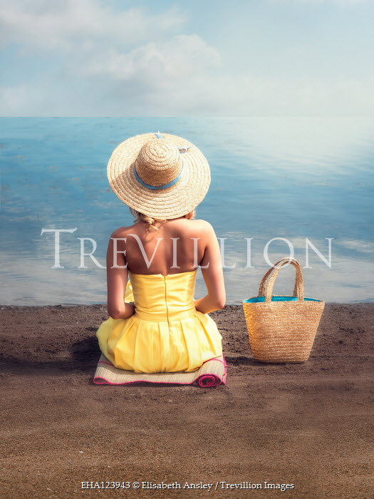 Elisabeth Ansley WOMAN WITH STRAW HAT AND BAG SITTING ON BEACH Women