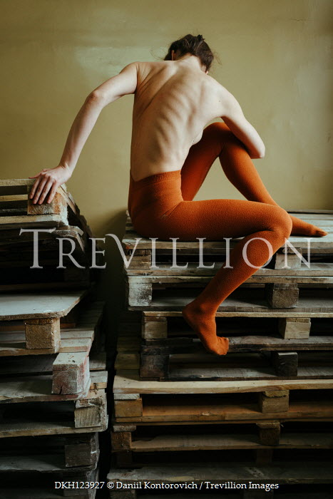 Daniil Kontorovich WOMAN IN TIGHTS SITTING ON WOODEN CRATES Women