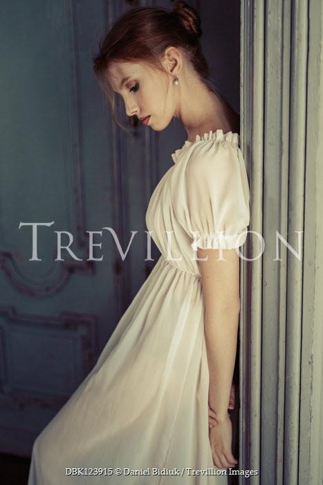 Daniel Bidiuk SERIOUS WOMAN IN WHITE DRESS INDOORS Women