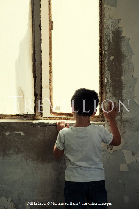 Mohamad Itani LITTLE BOY IN SHABBY HOUSE BY WINDOW Children
