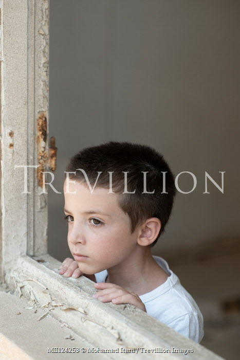 Mohamad Itani SAD LITTLE BOY IN SHABBY HOUSE BY WINDOW Children