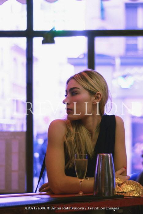 Anna Rakhvalova BLONDE WOMAN SITTING IN BAR WITH DRINK Women