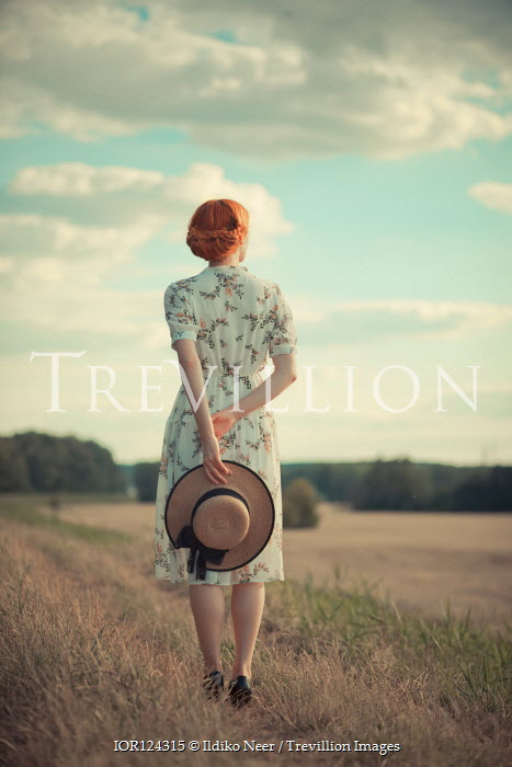 Ildiko Neer WOMAN WITH RED HAIR AND HAT IN SUMMERY COUNTRYSIDE Women