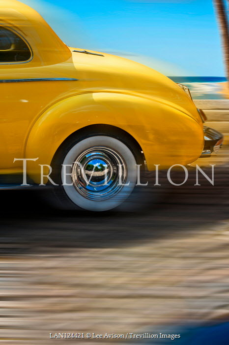 Lee Avison YELLOW CAR TRAVELLING BY SEA IN SUMMER Cars
