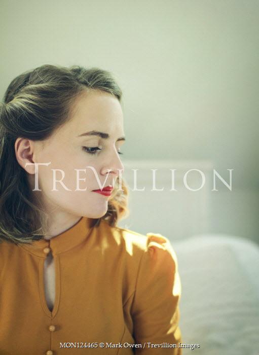 Mark Owen SERIOUS GIRL IN ORANGE DRESS SITTING ON BED Women