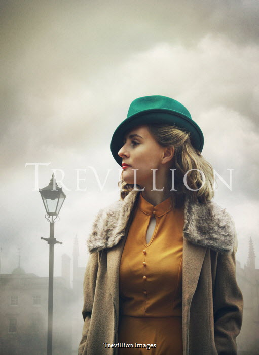 Mark Owen WOMAN IN HAT IN FOGGY CITY STREET Women