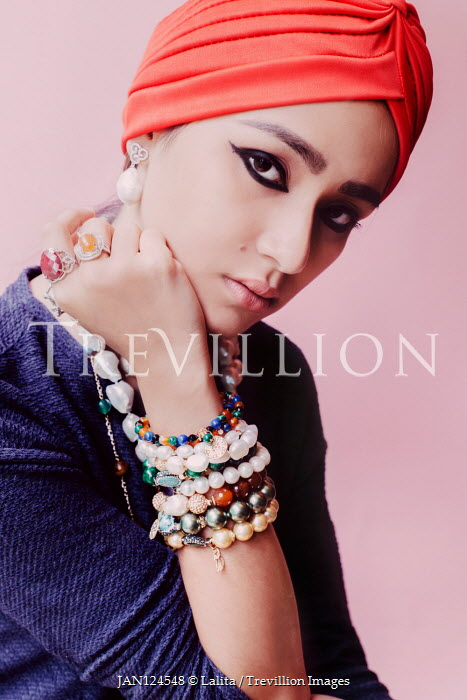 Lalita Young woman in headscarf with bead bracelets