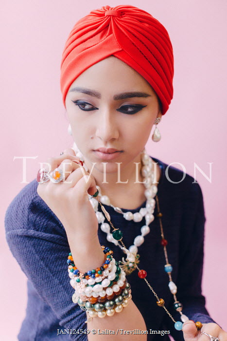 Jessica Lia Young woman in headscarf with bead bracelets