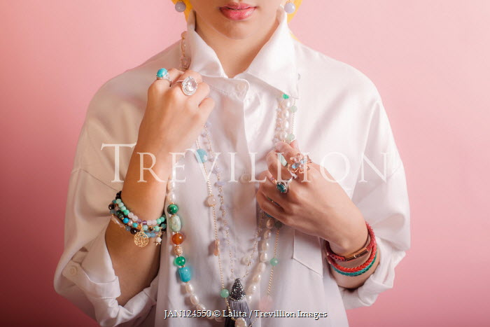 Jessica Lia Young woman in white blouse with necklaces and bracelets