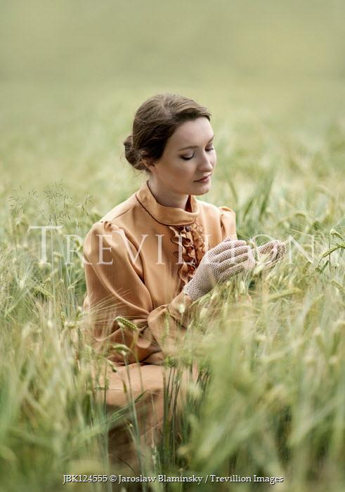 Jaroslaw Blaminsky Young woman in wheat field