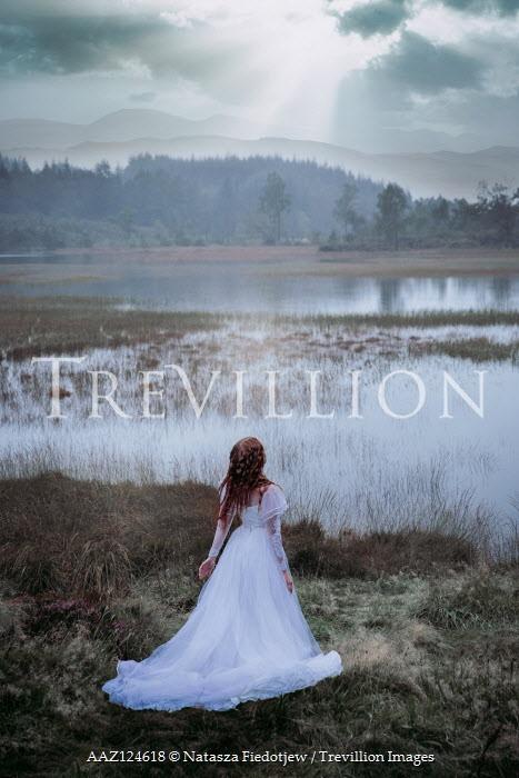 Natasza Fiedotjew Redhead girl in white eerie dress by lake