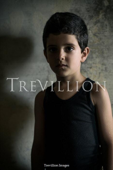 Mohamad Itani Boy in black tank top