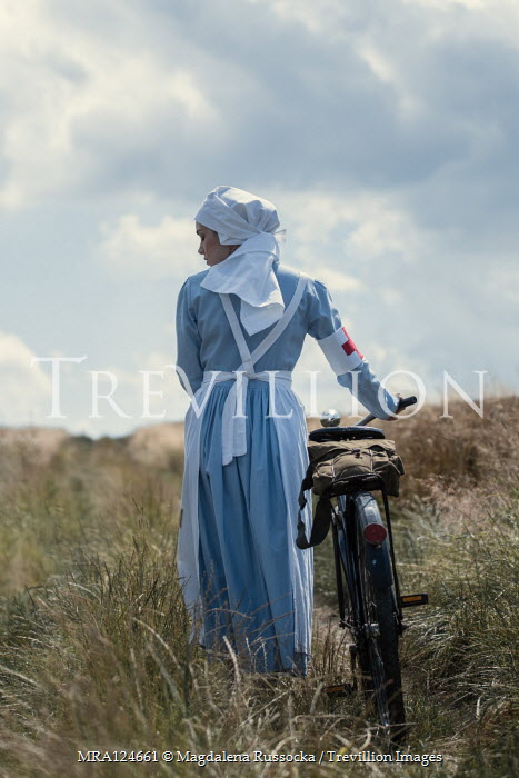 Magdalena Russocka wartime nurse with bike in countryside