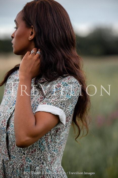 Rekha Garton Young woman in vintage dress in field