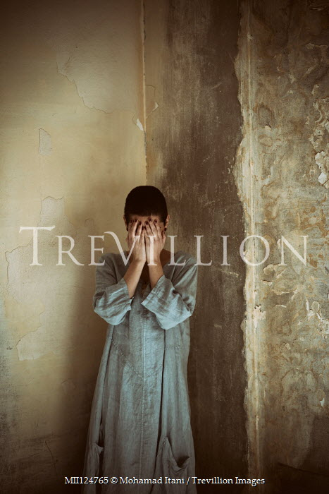 Mohamad Itani Young woman crying in abandoned house