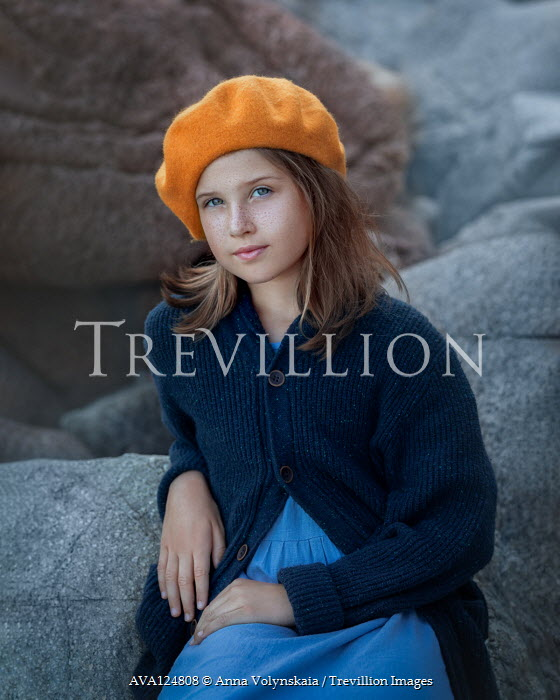 Anna Volynskaia Girl in yellow beret sitting on rocks