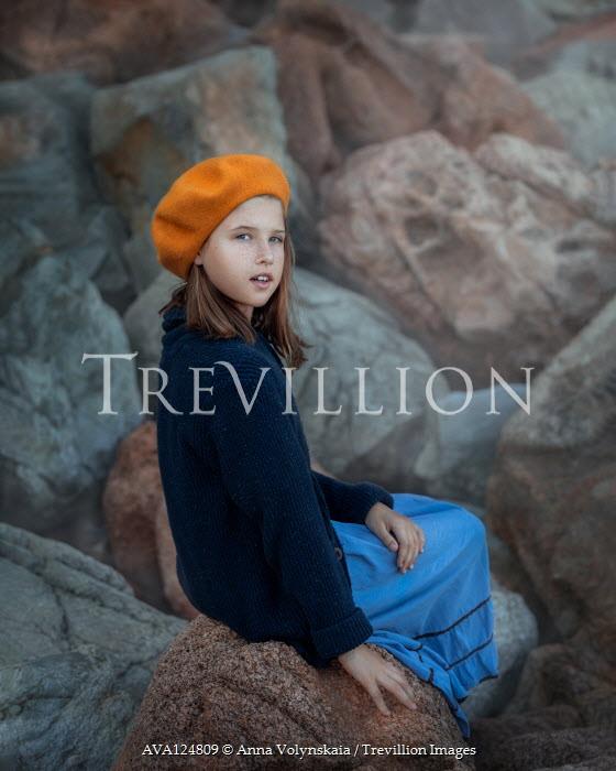 Anna Volynskaia Girl in yellow beret sitting on rocks