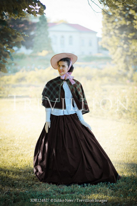 Ildiko Neer Victorian woman standing in garden