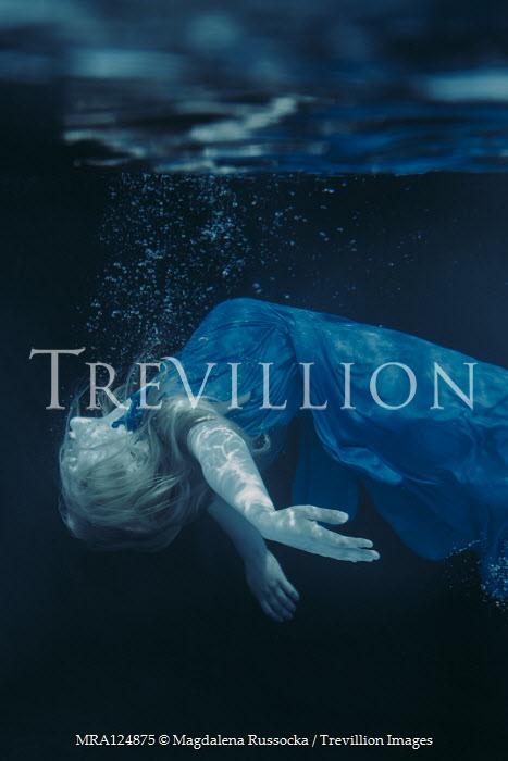 Magdalena Russocka woman in blue dress floating underwater